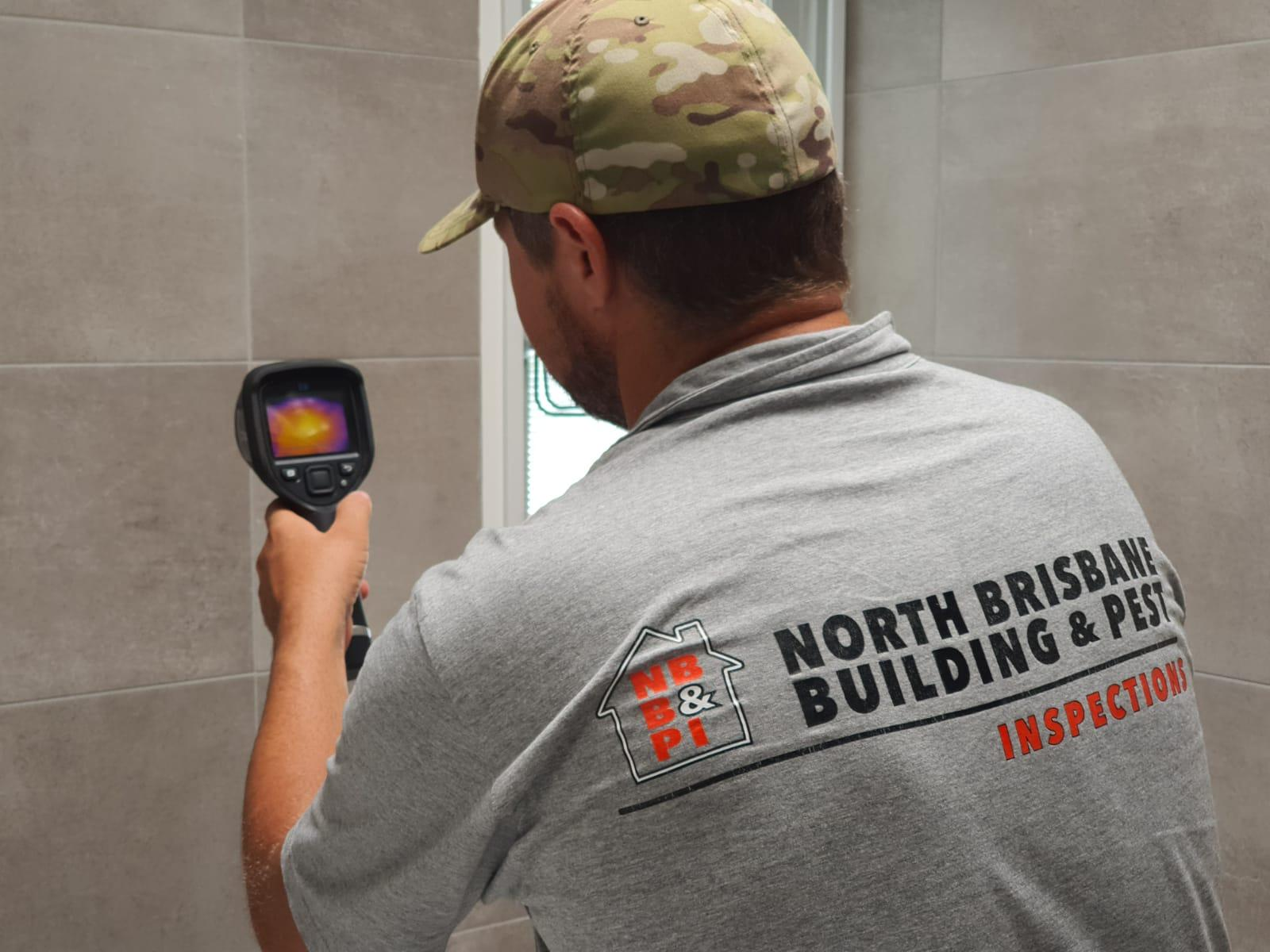 Brett is in the shower using the thermal imaging cameras to detect moisture
